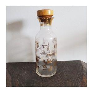 Vintage Jar with Gold Symbols and Cork